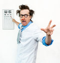 Crazy oculist in the white coat Royalty Free Stock Photos