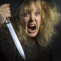 Crazy psychotic woman a young with murderous intent domestic violence Stock Images