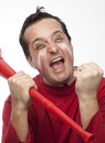 Crazy red team supporter a man dressed in clothes with facepaint and a vuvuzela cheering passionately Royalty Free Stock Photo