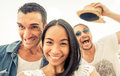 Crazy selfie with funny faces three people taking self portraits Royalty Free Stock Image
