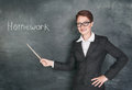 Crazy teacher with pointer and phrase homework on blackboard chalkboard Stock Images