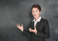 Crazy teacher on the school blackboard background Royalty Free Stock Photography