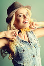 Crazy tie pretty blonde woman posing at studio jeans style Royalty Free Stock Photo