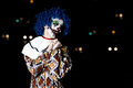 Crazy ugly grunge evil clown in town on Halloween making people shock and scared Royalty Free Stock Photo