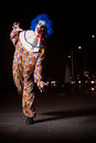 Crazy ugly grunge evil clown in town on halloween making people shock and scared Stock Images