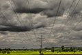 Crazy weather and electricity some bad approaching a row of power poles Royalty Free Stock Image
