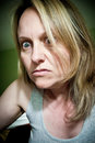 Crazy woman a with an angry and look on her face Stock Photography