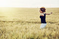 Crazy woman is jumping in the wheat field Royalty Free Stock Photo