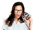 Crazy young woman with an old camera Royalty Free Stock Image