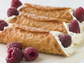Cream Brandy Snaps with Raspberries Royalty Free Stock Image
