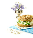 Cream cheese bagel with cress garnish against white copy space Royalty Free Stock Images
