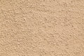 Cream colored bumpy background closeup to a Royalty Free Stock Photos