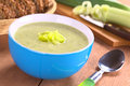 Cream of leek soup fresh homemade creamy in blue bowl with a basket wholewheat bread in the back selective focus focus on the Royalty Free Stock Images