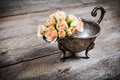 Cream pink roses in old metal bowl Royalty Free Stock Photo