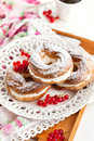 Cream puff rings decorated with fresh red currant choux pastry Royalty Free Stock Image