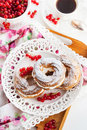 Cream puff rings decorated with fresh red currant choux pastry Stock Photography