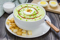 Cream soup with avocado, garnished with egg and croutons Royalty Free Stock Photo