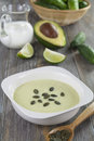 Cream soup of cucumber and avocado in a square bowl Stock Photography