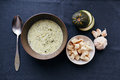 Cream soup of zucchini and garlic with croutons Royalty Free Stock Photo