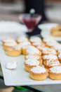 Cream tarts and jam vertical shot Royalty Free Stock Photography