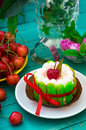 Creamy cake with cherries. Wooden turquoise background. Top view Royalty Free Stock Photo