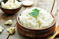 Creamy cauliflower garlic rice on a dark wood background the toning selective focus Royalty Free Stock Image