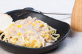Creamy corn pasta with bread in a black plate Stock Photography