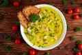 Creamy fish Salmon, leek, potato soup on wooden background Royalty Free Stock Photo