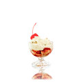 Creamy ice cream with cherries on plate in glass bowl Royalty Free Stock Photo