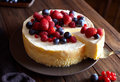 Creamy mascarpone cheese cake with strawberry and winter berries. New York Cheesecake. Close up. Royalty Free Stock Photo