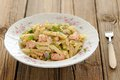 Creamy pasta with salmon and parsley in white plate Royalty Free Stock Photo