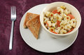 Creamy pepperoni pasta with and olives with rosemary garlic bread Stock Photography