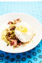Creamy polenta with shiitake stew crispy bacon and fried egg sweet cream Stock Photo