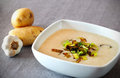 Creamy potato soup with fried leek Royalty Free Stock Photo