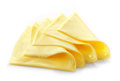 Creamy processed cheese slices on white background Stock Photo