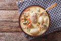 Creamy soup with chicken and vegetables close up. Horizontal top Royalty Free Stock Photo
