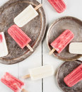 Creamy and strawberry popsicles Royalty Free Stock Photo