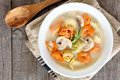 Creamy tortellini and mushroom soup, above scene on rustic wood Royalty Free Stock Photo