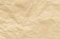 Creased brown paper texture background closeup to Royalty Free Stock Photos