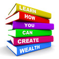 Create wealth creating concept books piled up with text on how to learn to creating white background Stock Photo