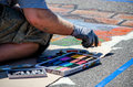 Creating art on the street a man works with pastels to make colorful chalk using road in st joseph michigan as his canvas Royalty Free Stock Image