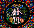Creation of adam and eve stained glass window in the church dinant belgium Stock Photography
