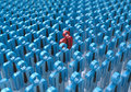 Creative abstract individuality uniqueness and leadership busin business concept single red d people figure in crowded group of Stock Photo