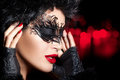 Creative artistic masquerade makeup high fashion portrait with dramatic black twirls and tendrils on a gorgeous dark haired woman Royalty Free Stock Photography