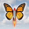 Creative breakthrough business metaphor as a rocket with monarch butterfly wings blasting off to higher levels of success as a Royalty Free Stock Images