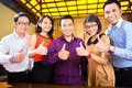 Creative business asia team meeting in office asian agency businesspeople its a good and young thumbs up Royalty Free Stock Photography