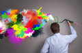 Creative business businessman painting abstract colorful design on gray background concept for creativity imagination and Stock Image