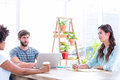 Creative business people using laptop in meeting Royalty Free Stock Photo