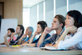 Creative business team listening at meeting in conference room Royalty Free Stock Photo