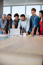 Creative business team looking at presentation in laptop Royalty Free Stock Photo